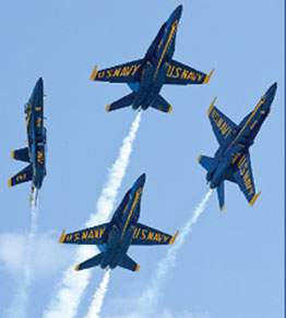 Four Blue Angels planes breaking formation